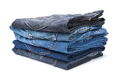 Folded jean stack on white background Stock Image