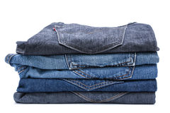 Folded jean stack on white background Stock Images