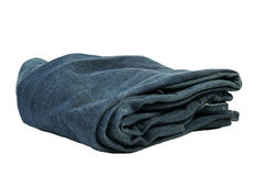 Folded Jeans. Isolated folded blue jeans against white background Royalty Free Stock Images