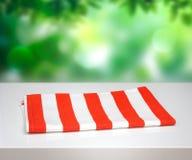 Folded kitchen cloth napking on white table natural background. Stock Image