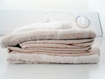 Folded Laundry. (towels) sitting on top of a clothes dryer. Focus on towels royalty free stock photography