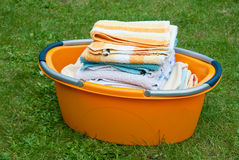 Folded laundry in basket Stock Image
