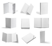 Folded leaflet white blank paper template book. Collection of various  blank folded leaflet white paper on white background. each one is shot separately Royalty Free Stock Photo
