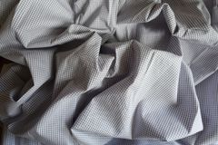 Folded light grey classic chequered cotton Royalty Free Stock Image