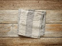 Folded linen napkin. On old wooden table, top view stock images