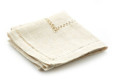 Folded linen napkin. On a white background Royalty Free Stock Photography