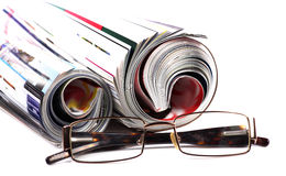 Folded magazines and specs Stock Photos