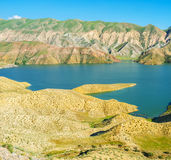 The folded mountains. On the banks of Azat Reservoir are covered with poor vegetation, Ararat Province, Armenia Royalty Free Stock Photography