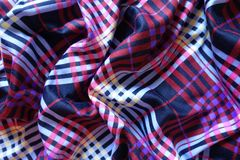 Folded multicolored fabric Stock Images
