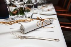 Folded napkin laid with malt on the table Royalty Free Stock Image