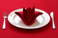 Folded napkin like a rose bud stock photo