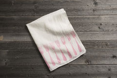 Folded Napkin with Pink Fork Pattern on Wooden Surface Stock Photography