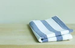 Folded napkin on table Royalty Free Stock Image