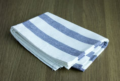 Folded napkin on table Royalty Free Stock Images