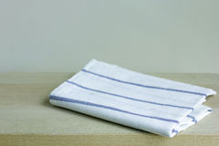 Folded napkin on table Stock Image