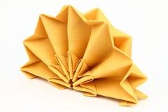 Folded napkin. On the white background stock photography