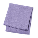 Folded napkins violet color on white background Royalty Free Stock Images