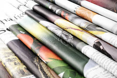 Folded newspapers background stock image