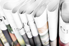 Folded newspapers standing Stock Photo