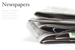 Folded newspapers on white background Stock Images