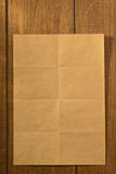 Folded note paper on wood. En background stock photography