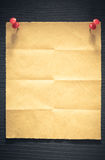 Folded note paper on wood. En background Stock Image