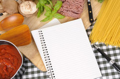 Folded recipe book with ingredients for Italian spaghetti bolognese, copy space Royalty Free Stock Photography