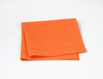 Folded orange napkin Royalty Free Stock Photography