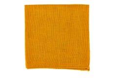 Folded orange textile napkin on white Royalty Free Stock Photo