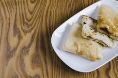 Folded pancake in a plate on a wooden background malaysian delicacies Stock Image
