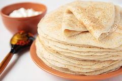 Folded pancake on stack of pancakes Stock Images