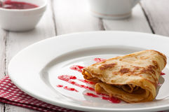 Folded pancake on white plate Stock Photos