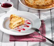 Folded pancake on white plate Stock Images