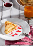 Folded pancake on white plate Royalty Free Stock Photography