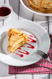 Folded pancake on white plate Royalty Free Stock Photos