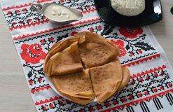 Folded pancakes served with sour cream and cottage cheese Royalty Free Stock Photography