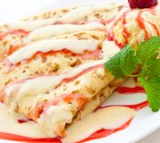 Folded pancakes with vanilla and raspberry sauce Stock Images