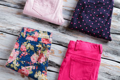 Folded pants with floral pattern. Stock Photos