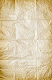 Folded Paper. Background of old wrinkled and folded sheet of paper stock photo