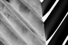 Folded paper abstract. Patterns on a white paper makes rythm on a composition Stock Photo