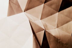 Folded paper abstract. In sepia tone stock images