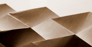 Folded paper abstract. With a shapes in sepia tone stock photos
