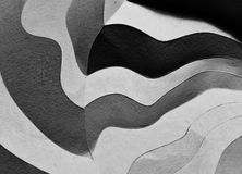 Folded paper abstract. Abstract with a white folded paper with a curved lines stock photo