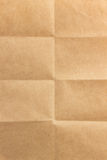 Folded paper. Folded brown paper as texture royalty free stock images