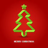 Folded paper Christmas green tree on a red background Royalty Free Stock Photo