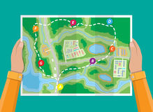 Folded paper city map in hands royalty free illustration