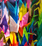 Folded Paper Cranes. Close up of folded paper origami cranes that are made by school children and displayed at the Children`s Peace Memorial in Hiroshima Japan stock images