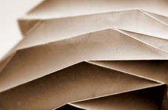 Folded paper. Detail in sepia tone stock images