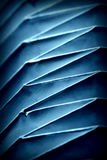 Folded paper form in blue color Stock Images
