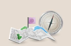 Folded paper map with pointer flag and compass Royalty Free Stock Photography